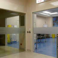 Automated Frameless Glass Cavity Sliders in hospital theatre