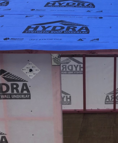 The 'Marshall Weatherization System which consists of 5 key components: Tekton or HYDRA Wall Underlay, Pro-Sill or Super-stick Flashing Tape, Trade-Seals, Seam Tape and HYDRA Roof Underlay.