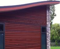 """J61 Profiled weatherboard, bandsawn face finish, coated in Dryden """"Autumn""""."""
