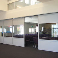 Bypass sliding door system with 2-5 doors sliding from one pocket