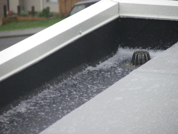 Combined use of 1mm Black Butynol in gutters and 1.5mm Dove Grey on roof areas