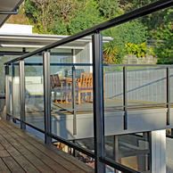 Edge fully framed glass balustrade with top and bottom rail, face fixed