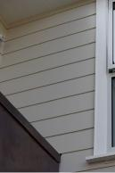 A dressed face finished bevelback weatherboard with a paint finish was specified for this reclad in Takapuna.