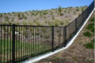 Long Bay sub development required a panel that would contour with the rolling hills while offering balustrade compliance.  Installed along path ways, retaining walls, parks and stairs.